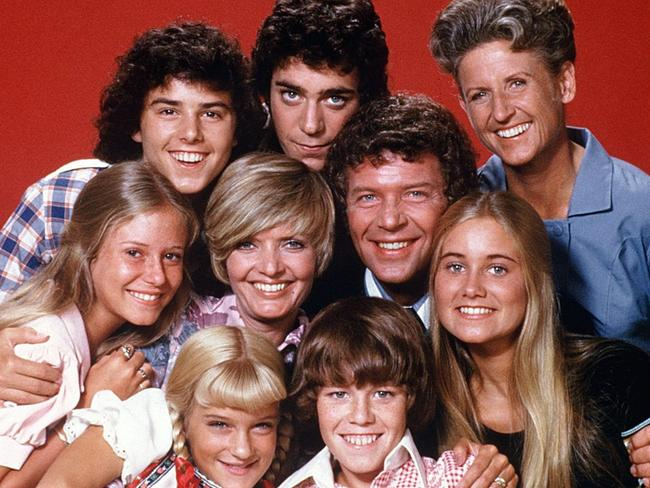 The cast: (front row) Susan Olsen, Mike Lookinland (middle row) Eve Plumb, Florence Henderson, Robert Reed, Maureen McCormick (back row) Christopher Knight, Barry Williams, Ann B. Davis.