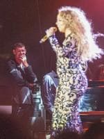 HE may not have known many of her songs but that didn't stop James Packer from rocking out as his girlfriend Mariah Carey performed in Israel ...