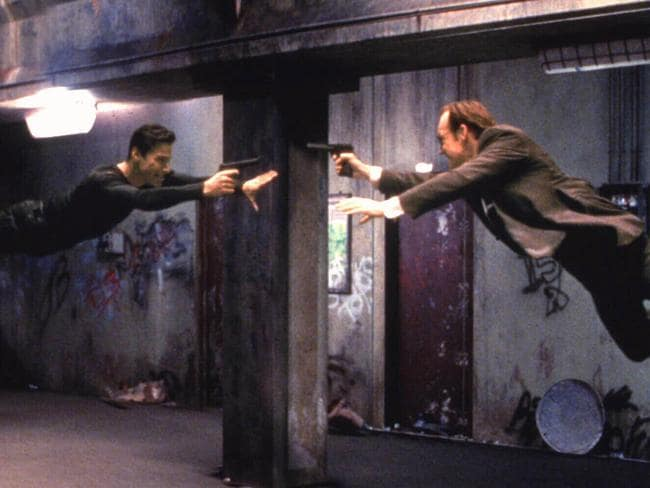 Keanu Reeves with Hugo Weaving in 'The Matrix'.