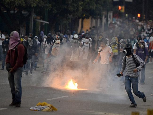 Marching together ... student demonstrators in the east of Caracas. Picture: AFP /Juan Barreto