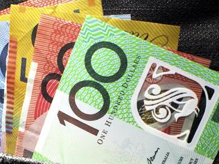 Budget2016 - stock images to be used for Budget 2016 stories. Australian money including 100, 50, 5, 10 and 20 dollar notes, in back pocket of a man's black charcoal jeans pocket. Vertical. Picture: istock