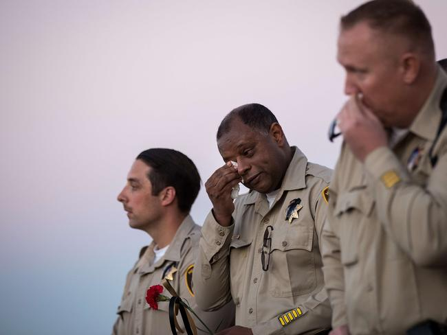 An officer wipes away tears during a vigil for Las Vegas Metropolitan Police Department Officer Charleston Hartfield who was killed in the mass shooting. Picture: Drew Angerer/Getty Images/AFP