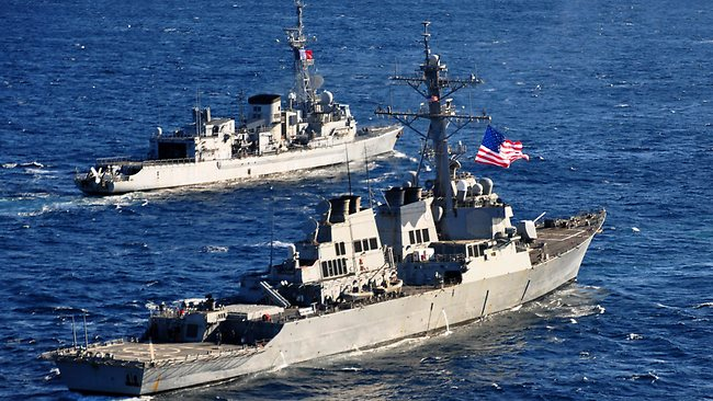 AT SEA - FEBRUARY 26, 2013: In this handout released by the U.S. Navy, the U.S. Navy guided-missile destroyer USS Barry (DDG 52) (foreground) pulls into formation with the French Marine Nationale anti-submarine frigate Jean de Vienne (D 643) during exercise Proud Manta 2013 in the Ionian Sea on February 26, 2013 at sea. In a response to a alleged chemical weapons attack on its own people by the Syrian regime the USS Mahan, the USS Barry, the USS Ramage, and the USS Gravely, all Arleigh Burke-class destroyers carrying Tomahawk land-attack missiles, are en route or in position in the eastern Mediterranean for a possible strike on Syrian military assets on August 28, 2013. (Photo by U.S. Navy via Getty Images)