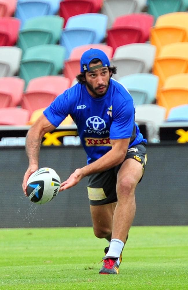 Johnathan Thurston passes the ball during a Cowboys training session.