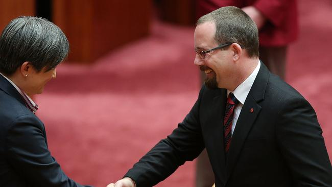 Warm welcome ... Senator Ricky Muir is congratulated by Senator Penny Wong
