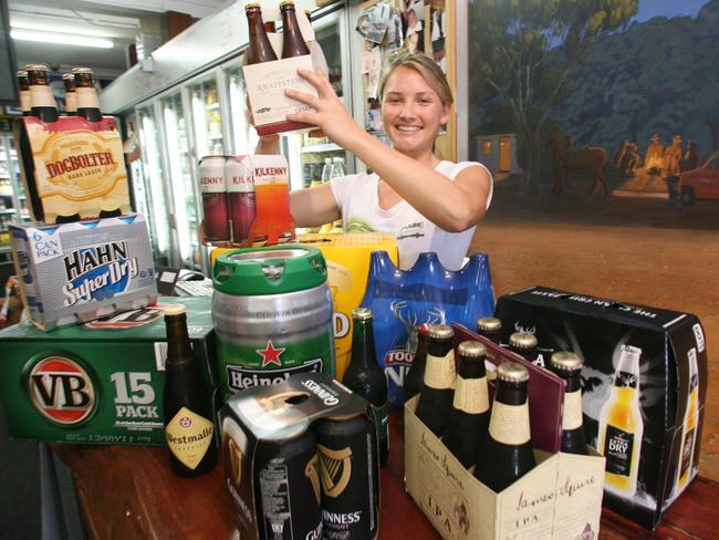 Alcohol comes in all shapes and sizes ... Emily Webber in her parent's bottle shop, Berkeley Vale Cellars, on the NSW Central Coast.