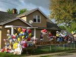Cleveland's House of Horrors : the family house of Gina DeJesus, one of the three women which were held captive for a decade, is decorated by well wishers ahead of her return. Photo: AFP/Emmanuel Dunand