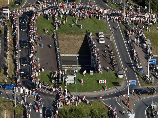 Mourners gather to pay their respects to the convoy of hearses carrying the bodies of victims MH17 in the Netherlands. Picture: Jerry Lampen