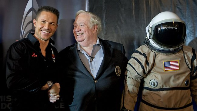 Felix Baumgartner, left, shakes hands with United States Air Force Col. (Ret.) Joe Kittinger, right, following the Red Bull Stratos press conference in New York announcing Baumgartner's plan to attempt to become the first person ever to break the speed of sound with the human body. (AP Images for Red Bull Stratos, David Goldman)