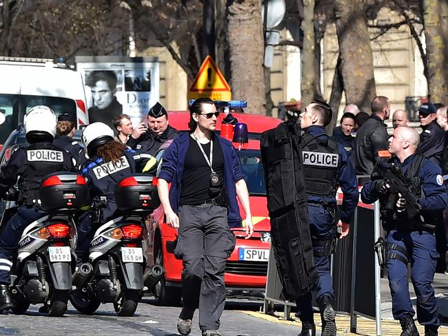 French Police officers secure the scene near the Paris offices of the International Monetary Fund in Paris, after a letter bomb exploded in the premises. Picture: AFP/Christophe Archambault