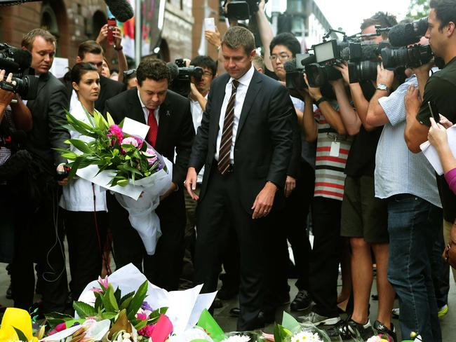 NSW Premier Mike Baird at the flower memorial.