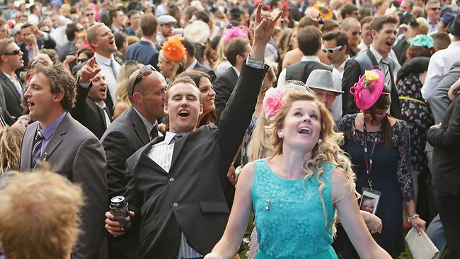 Racegoers dance as a band plays music after the Melbourne Cup at Flemington Racecourse . Getty