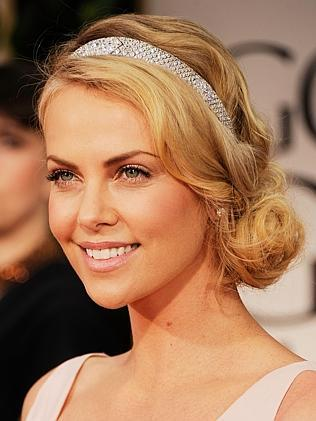 Although rumours also circulated that Clooney had his eye on non-other than oscar-winning actress Charlize Theron that same year. Picture: Getty