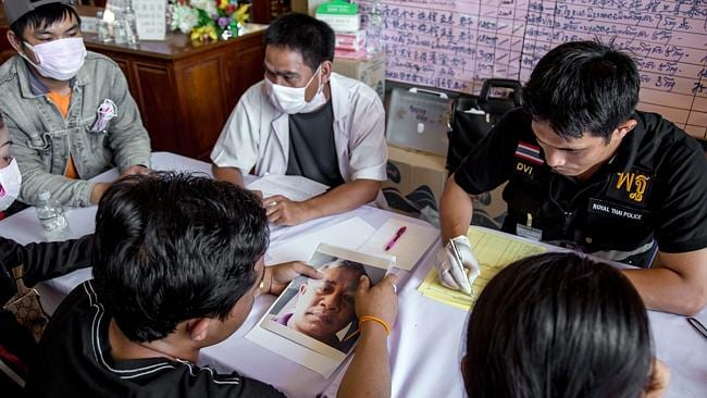Painstaking process: Thai Disaster Victims Identification officials with families of missing passengers in the Lao Airlines crash in October this year. Picture: Graham Crouch.