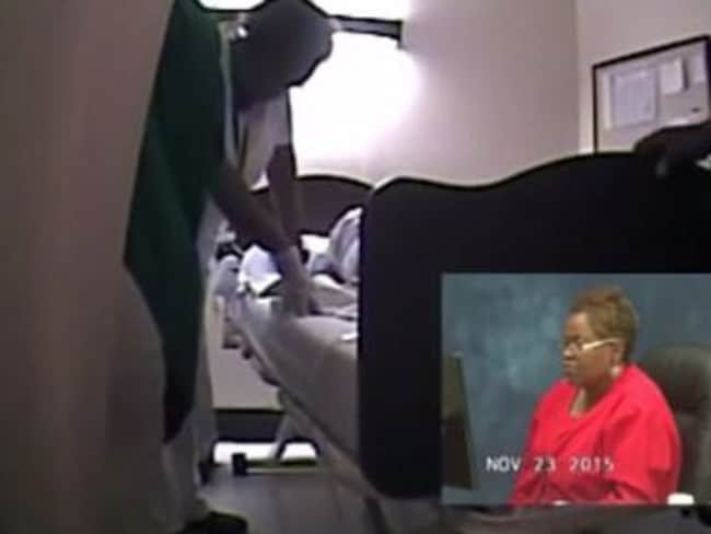 Three nurses attend: This is the moment nurse supervisor Wanda Nuckels (pictured touching the bed in the video, and watching the video in a red shirt) doubles over laughing. Picture: 11alive.