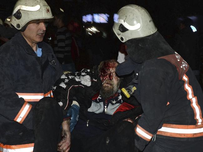 Firefighters carry a person wounded in an explosion in Ankara, Turkey. Picture: AP