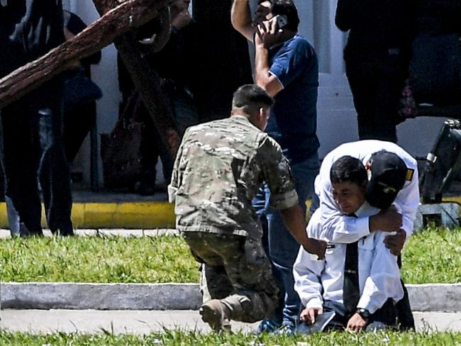 Relatives and comrades of 44 crew members of Argentine missing submarine, express their grief. Picture: AFP