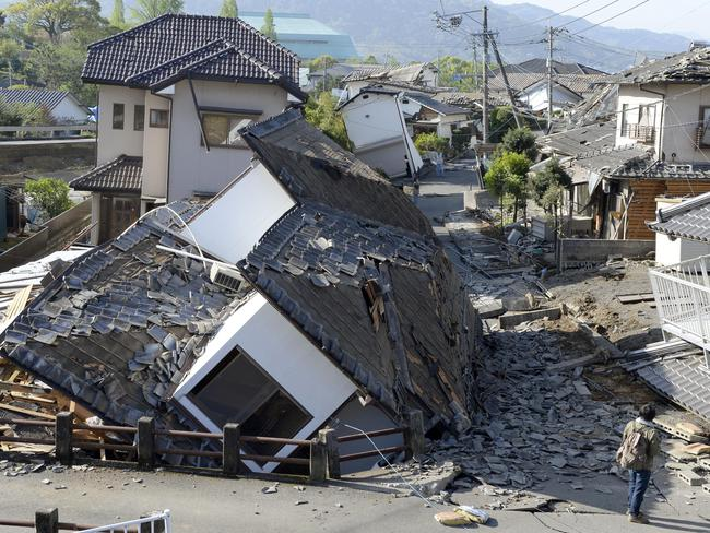 Houses are seen destroyed after an earthquake in Mashiki, Kumamoto prefecture, southern Japan. Picture: Ryosuke Uematsu/Kyodo News.