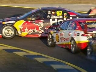 Scott McLaughlin takes out Shane Van Gisbergen on Saturday.