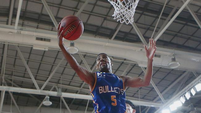 Lance Hurdle goes to the net for the Bullets against China.