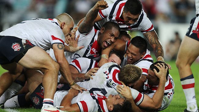 Roosters players celebrate after Anthony Minichiello scored the winning try in the last seconds of the South Sydney Rabbitohs v Sydney Roosters NRL game at ANZ Stadium in Homebush, Sydney. Picture: Brett Costello