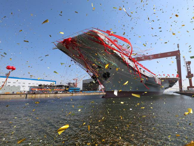 The newly-built aircraft carrier is transferred from dry dock into the water at a launch ceremony at a shipyard in Dalian in northeastern China's Liaoning Province. Picture: Li Gang/Xinhua via AP
