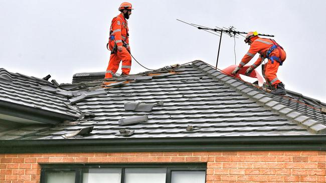 SES crews work on a damaged roof in Truganina. Picture: Tim Carrafa
