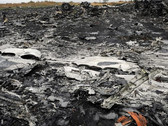 Field of destruction ... A mass of molten MH17 debris lay in a field. Source: AFP