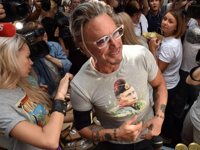 Rourke shows off his new purchase to photographers. Picture: AFP PHOTO