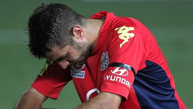 Adelaide United's Michael Zullo looking dejected after the 1-0 loss to the Mariners. Picture: Tony Feder.