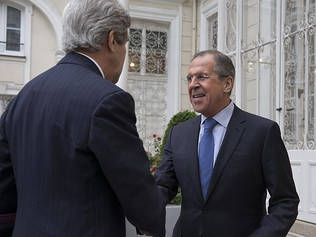 Cordial meeting ... US Secretary of State John Kerry, left, is greeted by Russian Foreign Minister Sergey Lavrov at the Russian Ambassador's residence for a meeting to discuss Ukraine, in Paris. Picture: Jacquelyn Martin