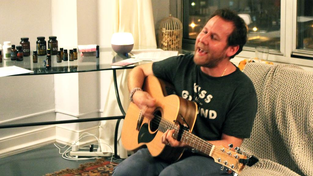 Spiritual journey ... Aussie rocker Ben Lee performs his hits and spruiks essential oils in a New York apartment for the Qollari Essentials Project. Picture: Jenni Dawes