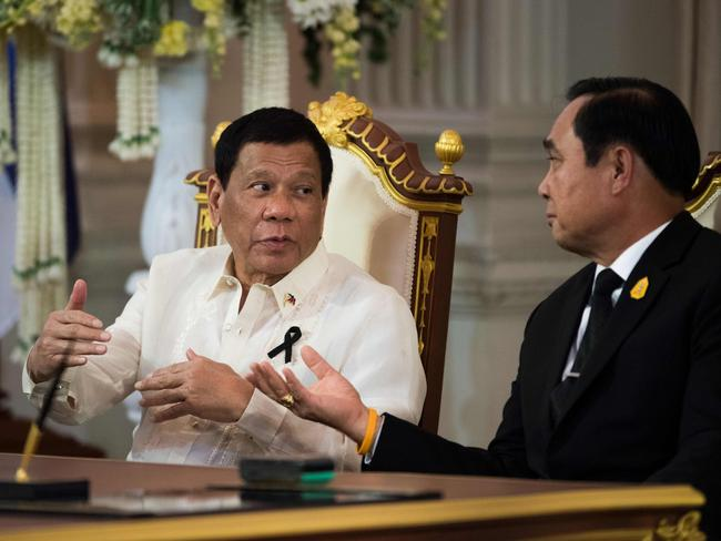 Philippines President Rodrigo Duterte (left) meets with Thailand Prime Minister Prayut Chan-O-Cha at the presidential palace in Bangkok on March 21 during Duterte's two-day official visit to Thailand. Picture: AFP/Roberto Schmidt