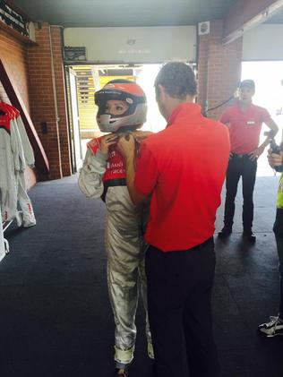 Me getting kitted up in a serious kind of driving suit