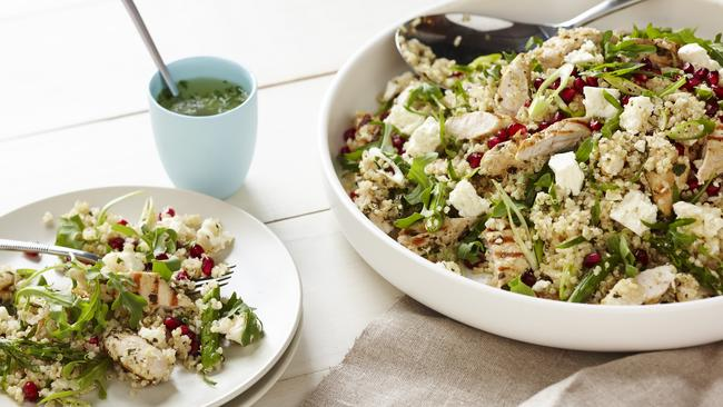 Preparing meals at home, like this quinoa, chicken and rocket salad, is a simple way to consume less calories.