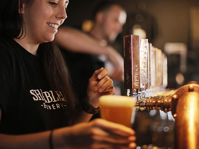 Genevieve Henderson serves an Afternoon Delight Summer Ale, brewed at the Shambles Brewery, Hobart. Picture: MATHEW FARRELL
