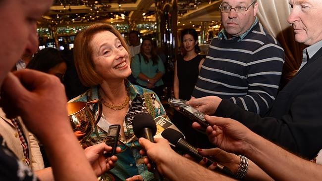 Gai Waterhouse talks to the media with her new-found friend, the Melbourne Cup. Picture: Tony Gough