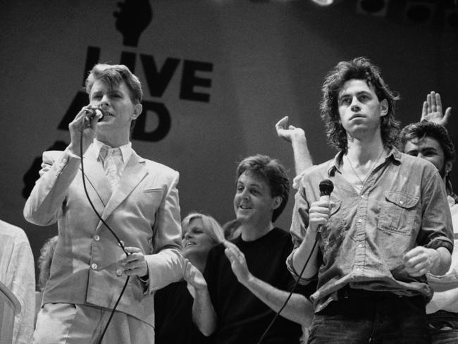 Flashback ... David Bowie, left, Paul McCartney, centre, and Bob Geldof, right, during the London leg of the Live Aid famine relief concert at Wembley Stadium on July 13, 1985.