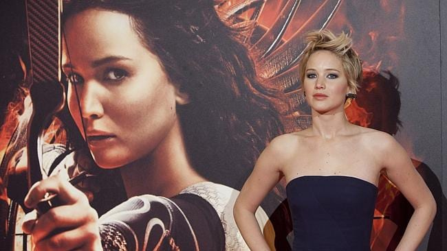 """Jennifer Lawrence poses for the photographers during the premiere of """"The Hunger Games: Catching Fire"""""""