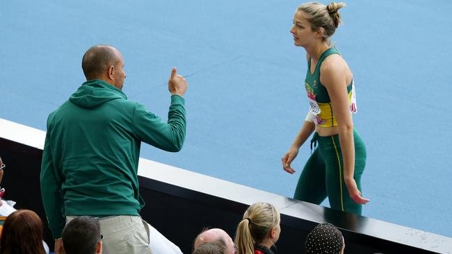 Eric Hollingsworth coaches Sophie Stanwell from the stands.