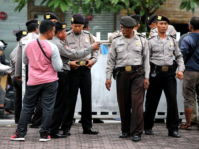 Police officers arrive at the Bali Parole office in Denpasar to prepare for Schapelle Corby's departure. Picture: Nathan Edwards
