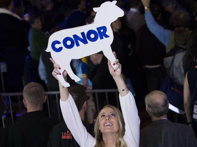 A supporter holds up a lamb cutout before Conor Lamb, Democratic congressional candidate for Pennsylvania's 18th district, spoke to supporters at an election night rally. Picture: Getty