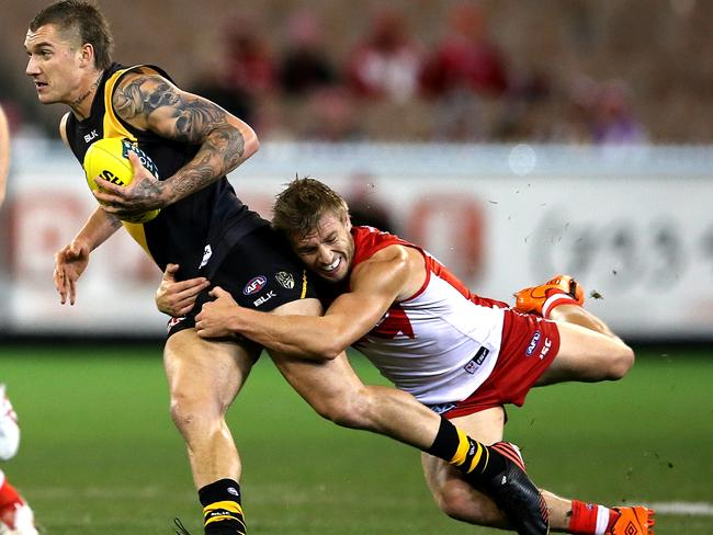 Dustin Martin can't escape a Kieren Jack tackle. Picture: Wayne Ludbey