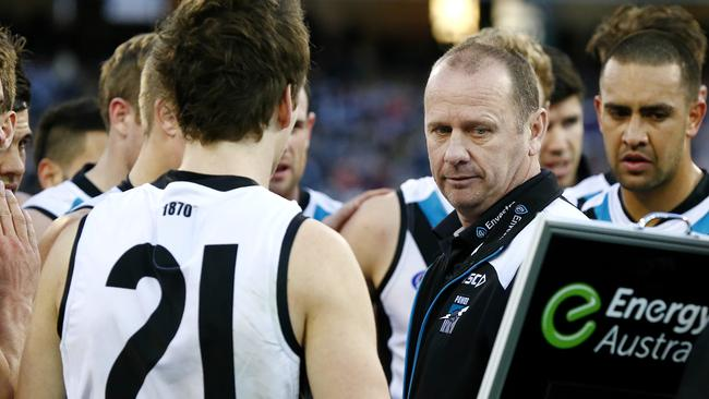 Ken Hinkley addresses his charges. Picture: Wayne Ludbey