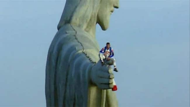 Freefalling: Baumgartner prepares to make the lowest BASE jump in history, leaping from the hand of Rio's Christ the Redeemer statue. Picture: YouTube