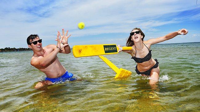 Sam Dauer and Sarah Mackay splash out at Elwood beach. Picture: Jason Edwards