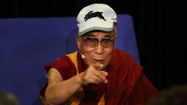The 14th Dalai Lama wearing a South Sydney Rabbitohs cap at a press conference at the Hilton Hotel, Sydney. Souths players Roy Asotasi and Nathan Merritt presented him with a cap and sweatshirt. Picture: Phil Hillyard