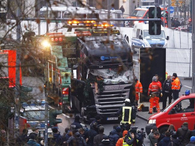 Security and rescue workers tend to the area after a lorry truck ploughed through a Christmas market. Picture: Michele Tantussi/Getty Images