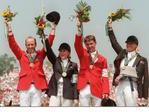 Australia's Olympic equestrian three-day edurance team Andrew Hoy, Wendy Schaeffer, Phillip Dutton and Gillian Rolton salute the crowd after receiving their gold medals at the 1996 Atlanta Olympic Games.