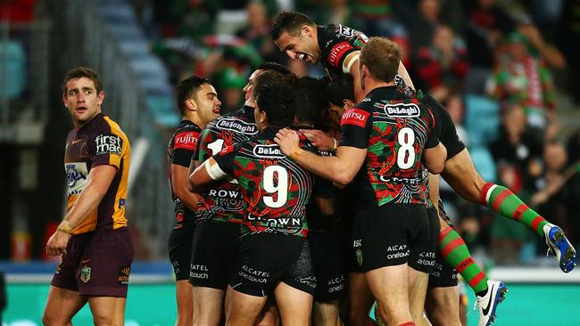 The Rabbitohs celebrate a try by Lote Tuqiri.